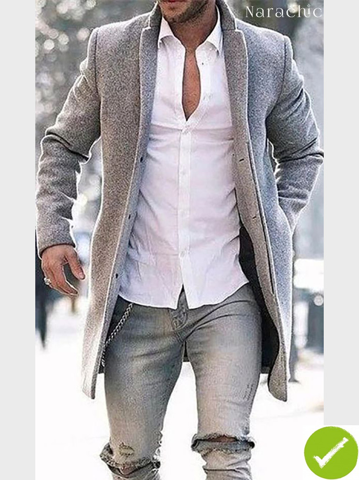 Dude in pale styish kashmere coat, torn jean, key chain, white shirt two top buttons undone.