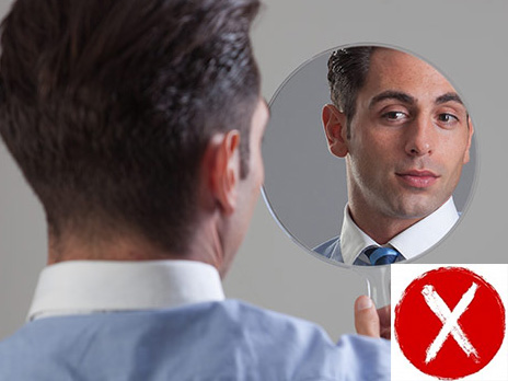 Guy smartly dressed looking at his face in the mirror. Conservative shirt and tie. Collar white rest pale blue.